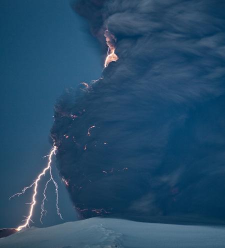 iceland volcano lightning. causing dirty lightning.